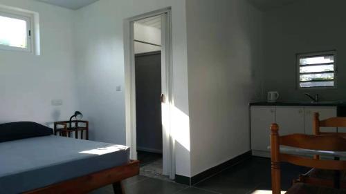 Cama ou camas em um quarto em Jambolana Studio