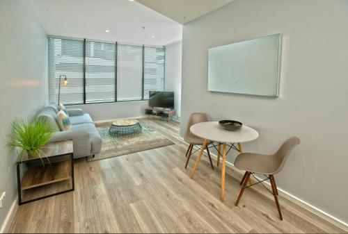 A seating area at Waterfront Melbourne Apartments
