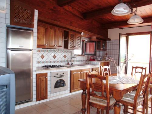 A kitchen or kitchenette at Villino Rosalia