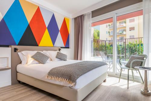 A bed or beds in a room at Aparthotel Adagio Rome Vatican