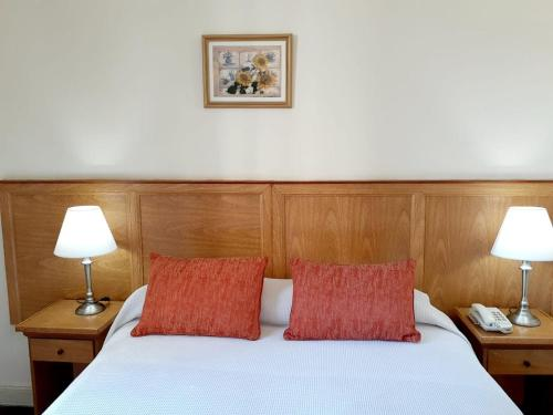 A bed or beds in a room at Hotel Benevento
