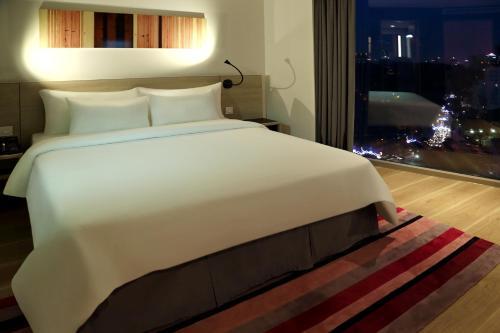 Un ou plusieurs lits dans un hébergement de l'établissement Liberty Central Saigon Citypoint