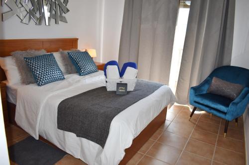 A bed or beds in a room at VILLA MOLEIRO- LA TEJITA