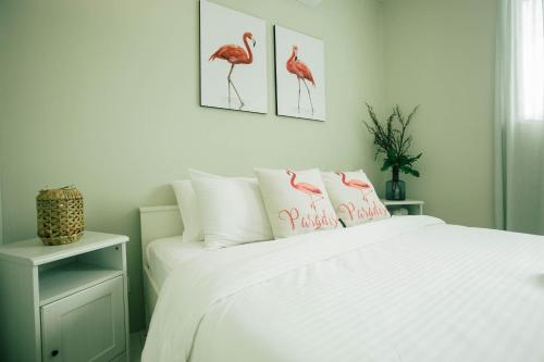 Ein Bett oder Betten in einem Zimmer der Unterkunft Villa Tiga (v3) @ Datai Valley