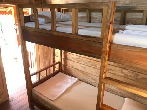 A bunk bed or bunk beds in a room at Beranda Ecolodge