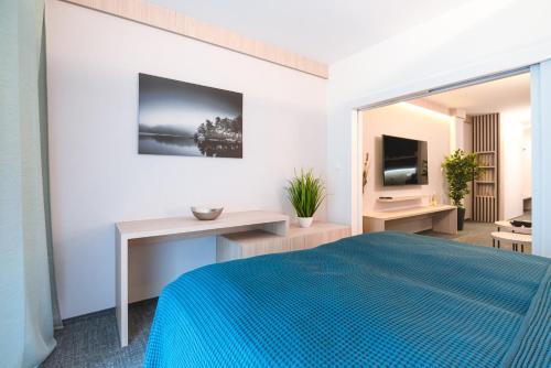 A bed or beds in a room at Apartman Pod Hrebienkom - C218