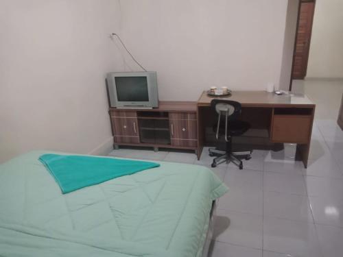 TV/Unterhaltungsangebot in der Unterkunft Suite Pakar Hotel