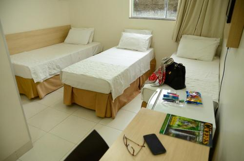 A bed or beds in a room at Hotel Capital