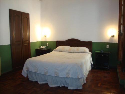 Cama o camas de una habitación en Hostal Recoleta Sur