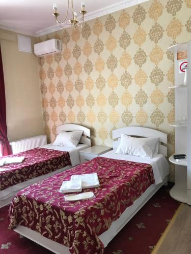 A bed or beds in a room at Hotel Comfort