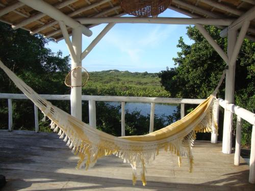 Uma varanda ou terraço em Pousada Casa da Praia Itaúnas