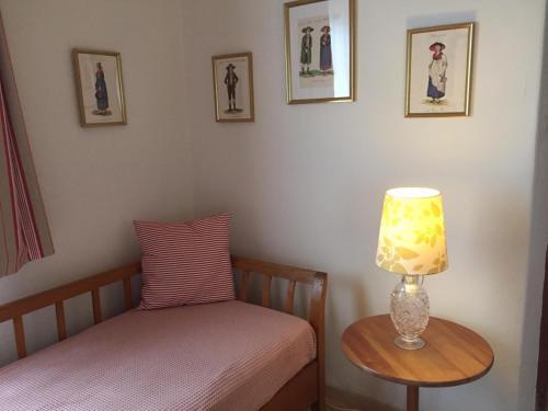 Ein Bett oder Betten in einem Zimmer der Unterkunft Villa Tadina Ferienwohnungen Mariazell