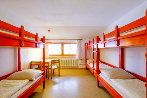 A bunk bed or bunk beds in a room at DJH Jugendherberge Pottenstein
