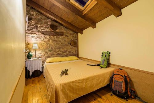 A bed or beds in a room at Refugi Rural Vall de Siarb