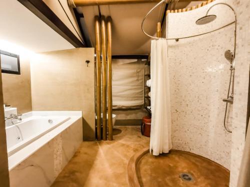A bathroom at Lala Mukha Tented Resort Khao Yai