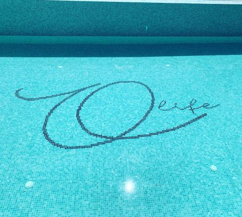 The swimming pool at or close to Olife Guesthouse