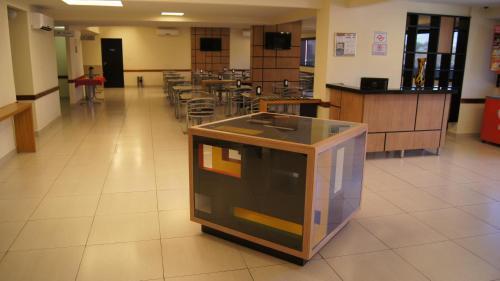 A cozinha ou cozinha compacta de Astro Hotel