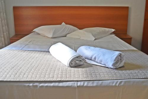 A bed or beds in a room at Hotel Ampiezza