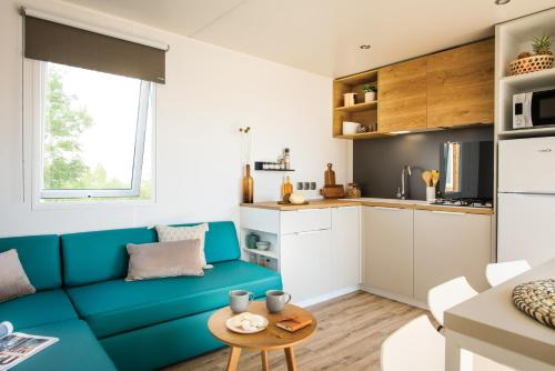 A kitchen or kitchenette at Camping Pascalounet