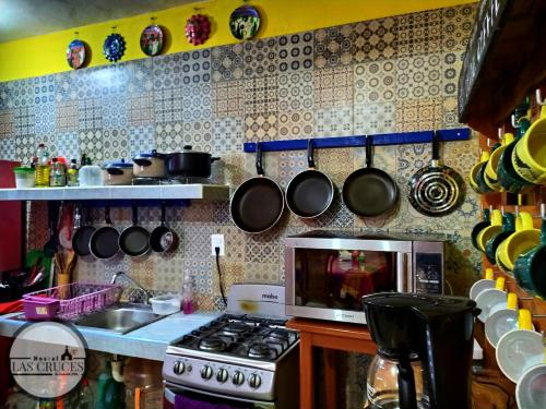 A kitchen or kitchenette at Hostal Las Cruces