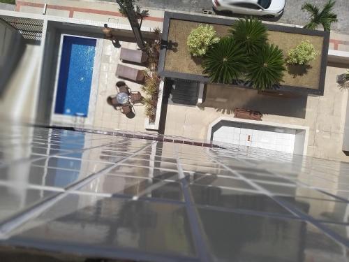A view of the pool at Apartamento Edifício Edécio Lopes or nearby