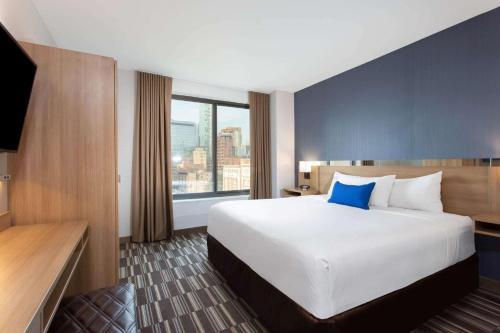 A bed or beds in a room at Microtel Inn by Wyndham Long Island City