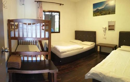 A bed or beds in a room at Happy Garden Resort
