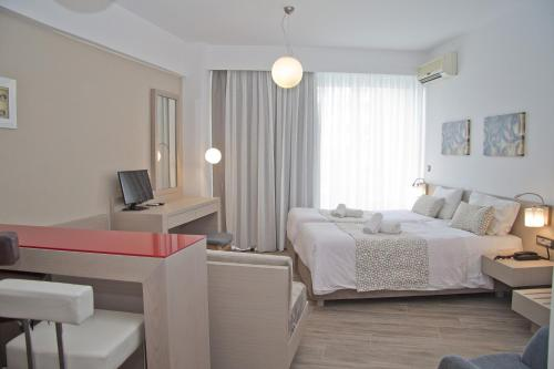 A bed or beds in a room at Hotel Christina