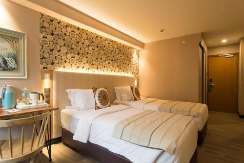 Кровать или кровати в номере Cuna Hotel