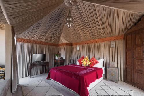A bed or beds in a room at Riad Spice by Marrakech Riad