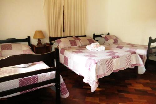 Cama ou camas em um quarto em Pousada Toca das Bromelias