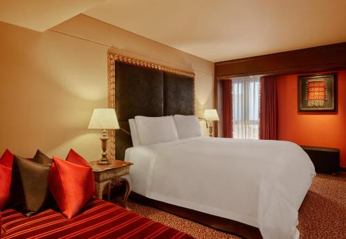 A bed or beds in a room at Palacio del Inka, a Luxury Collection Hotel by Marriott