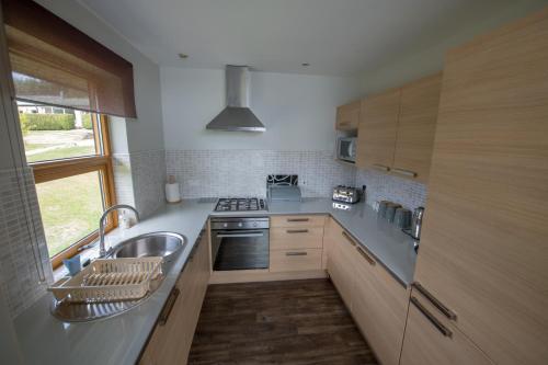 A kitchen or kitchenette at Loch Lomond Waterfront Luxury Lodges