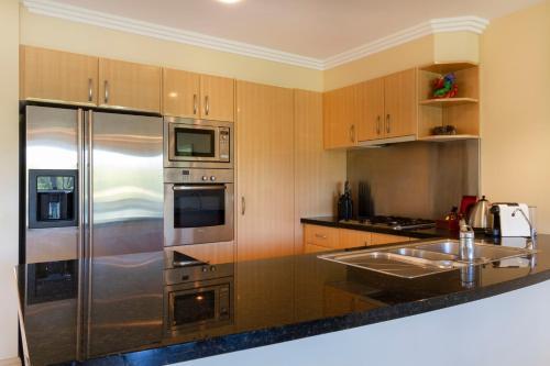 A kitchen or kitchenette at Paradise Links Resort Port Douglas