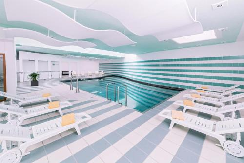The swimming pool at or near Terrassenhotel Reichmann