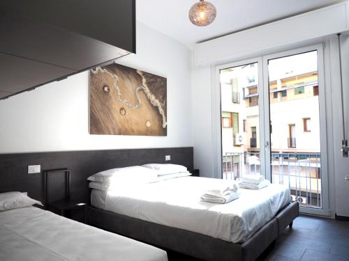 A bed or beds in a room at Pitti Apartment