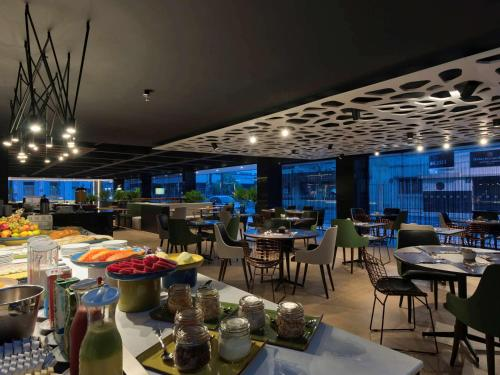 A restaurant or other place to eat at Novotel Itajai