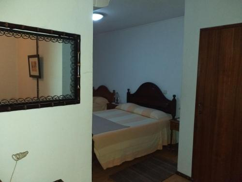 A bed or beds in a room at Residencial Encontro