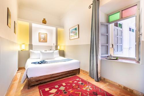 Ein Bett oder Betten in einem Zimmer der Unterkunft Riad Laila