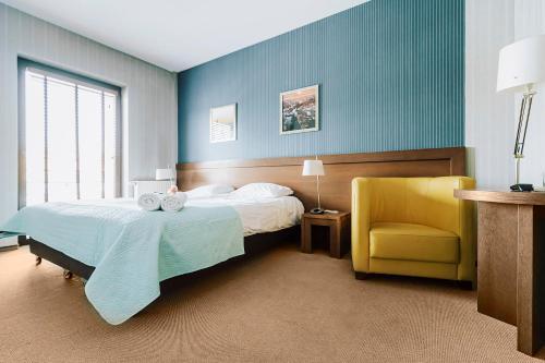 Łóżko lub łóżka w pokoju w obiekcie Hotel Willowa