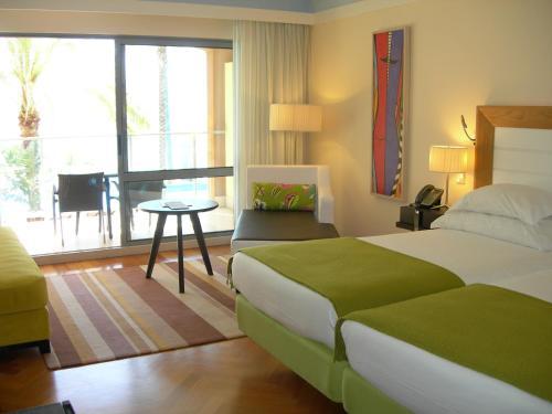 Uma cama ou camas num quarto em Pestana Promenade Ocean Resort Hotel