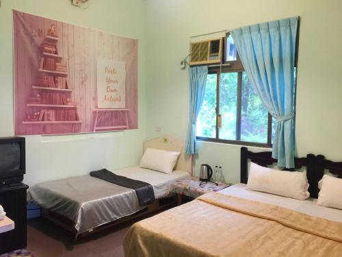 A bed or beds in a room at De Wang Villa