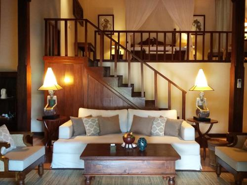 A seating area at Warwick Ibah Luxury Villas & Spa