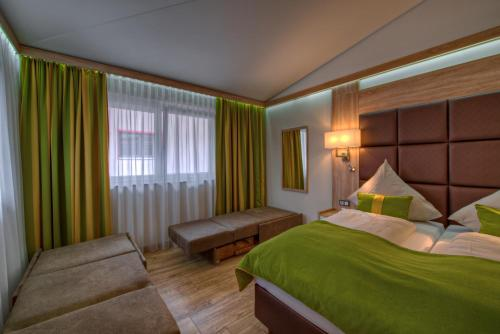 A bed or beds in a room at Best Western Plus Hotel Füssen