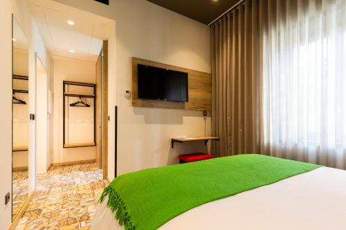 A television and/or entertainment center at ibis Styles Chaves