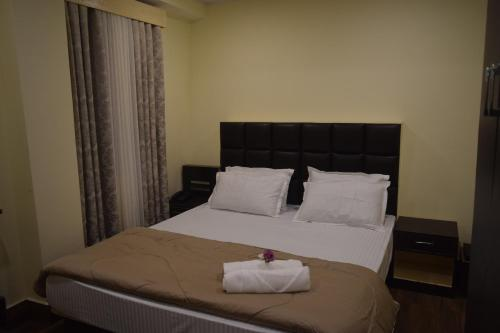 A bed or beds in a room at Denzong Khim