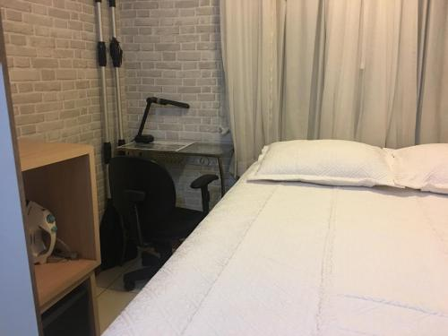 A bed or beds in a room at Life Resort - Flat Aconchegante