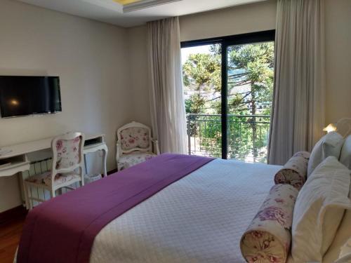 A bed or beds in a room at Villa D´Biagy Premium