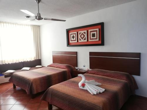 Ein Bett oder Betten in einem Zimmer der Unterkunft Hotel Los Girasoles