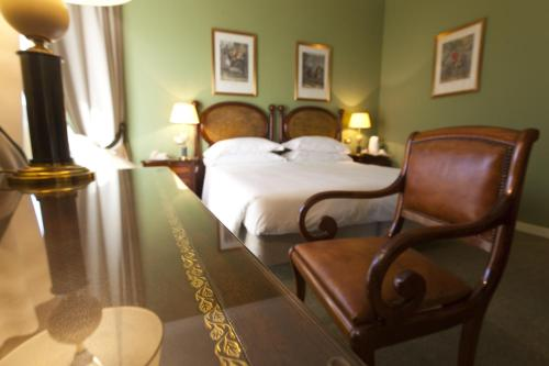 A bed or beds in a room at Palace Hotel